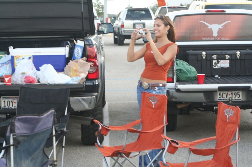 """Woman at a tailgate party for a UT football game"". Licensed under CC BY 2.5 via Wikimedia Commons."